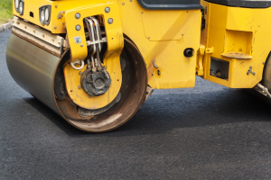 Asphalt roller truck paving a road in Orlando, Florida