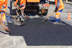Repairing an asphalt road surface in Brevard County, Florida