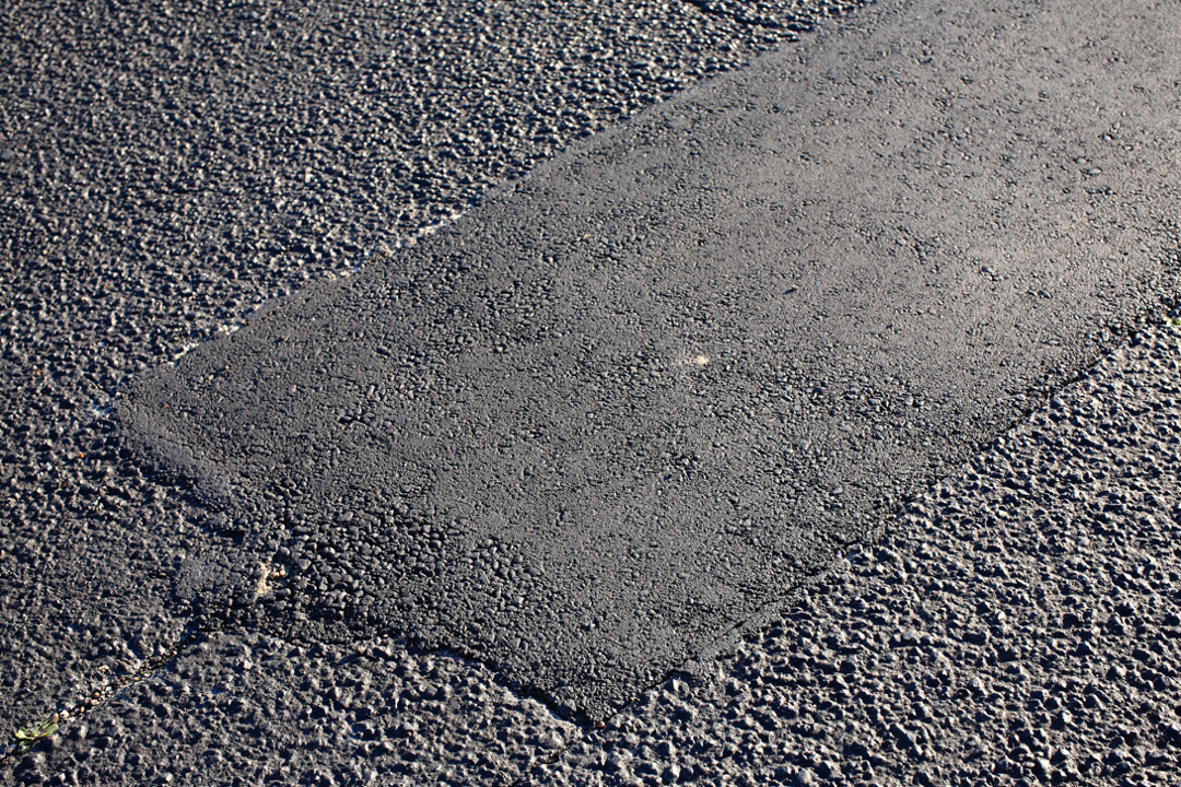 Asphalt patch repair at a parking lot in Brevard County, Florida