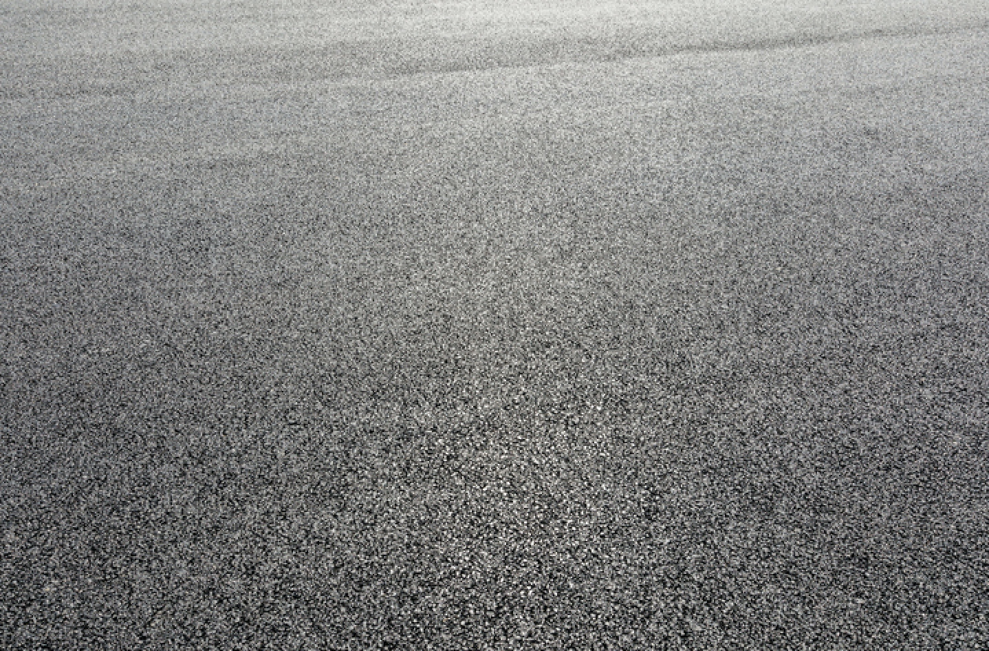 Sealcoated asphalt surface at a commercial parking lot in Gainesville, Florida