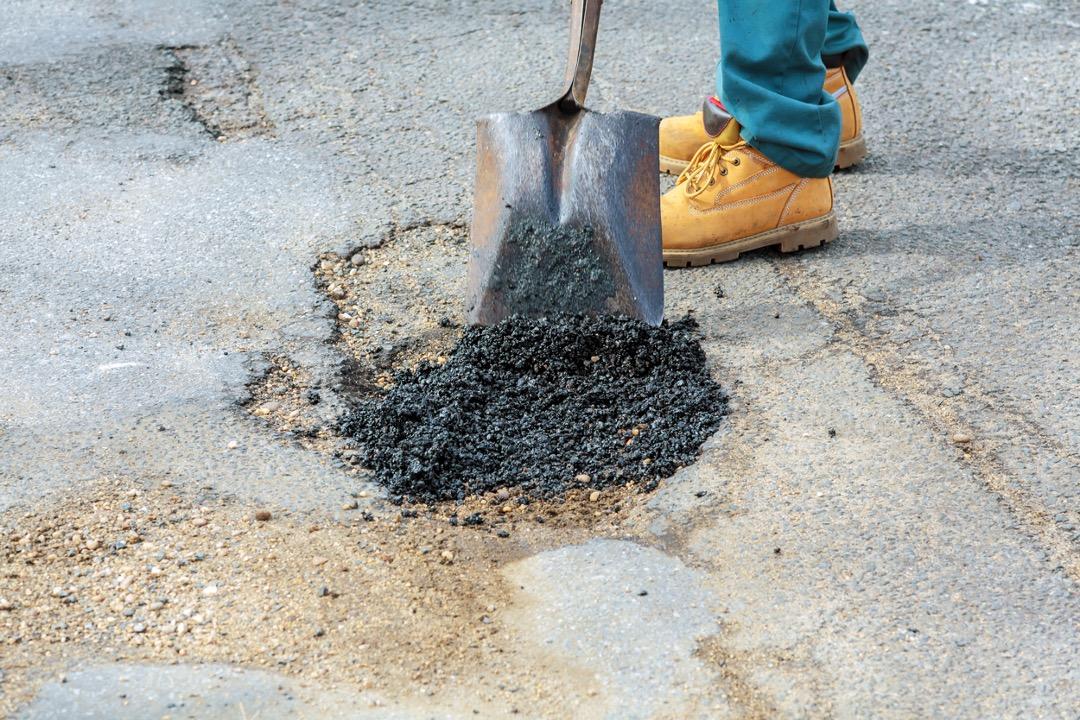 Asphalt maintenance at a parking lot in Ocala, Florida